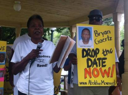 Rodney's mother, Sandra Reed, speaks on behalf of her son inside the Bastrop Co. Courthouse gazebo