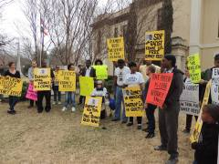 A group of supporters gather at lunchtime to tell Bastrop DA Bryan Goertz to Drop the Date!