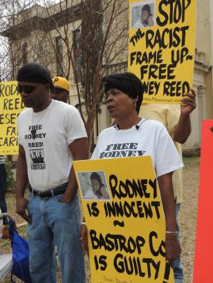 Rodney's mother, Sandra Reed, and his brother, Rodrick Reed, demonstrate outside the Bastrop Co. Courthouse