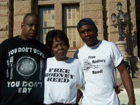Rodney's mother, Sandra Reed, stands with one of Rodney's brothers and a cousin in front of the Texas State Capitol Building