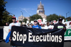 Exonerated former death row prisoners Gary Drinkard, Ron Keine, and Shujaa Graham lead a march in front of the Texas State Capitol