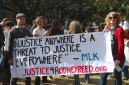 Supporters with Martin Luther King, Jr. banner at #blacklivesmatter march at UT Austin, Jan. 2015. Photo by Elizabeth Brassa