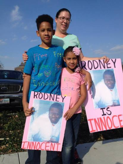 "Supporters from Houston pose in their hand made solidarity t shirts at the ""Rally For Justice for Rodney Reed"" on Feb. 21, 2015. Photo by Randi Jones Hensley"
