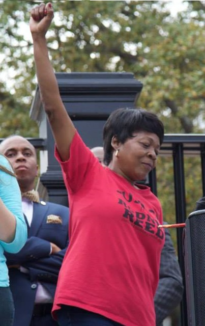 Sandra Reed, Rodney's mother, raises a fist for a crowd of supporters outside the Texas Governor's Mansion, Feb. 21, 2015