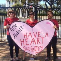 "Supporters delivered a big valentine to Gov. Greg Abbott on Feb. 14. The heart reads ""Gov. Abbott- Have a Heart. Save Rodney"""