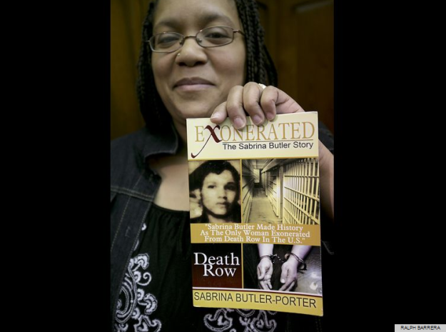 Sabrina Butler, who is the only woman to be exonerated from death row, holds a copy of her life story after she spoke along with people with the Witness to Innocence in support of abolishing the death penalty at a Capitol press conference Tuesday, March 3, 2015. Photo by Ralph Barrera for the Austin American Statesman