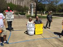 Outside the Court of Criminal Appeals, supporters kneel inside a 6' x 10' area representing the size of cells on Texas death row