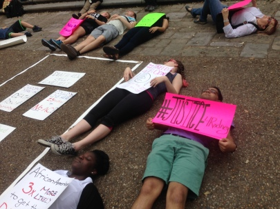 Students participate in a die-in at the foot of the UT tower on April 23, 2015. Photo by Mike Corwin