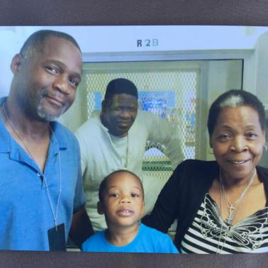 Rodrick, his son RJ, and Sandra Reed visit Rodney on death row